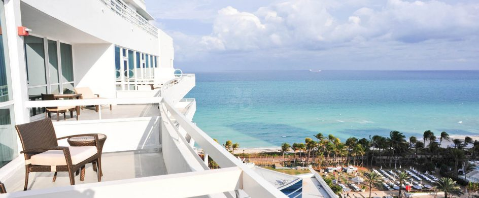 """top Miami Hotels for Summer 2014""  A guide through the top Miami Hotels for Summer 2014 balcony deluxe guestroom fontainebleau resort miami beach v112402 1600 944x390"